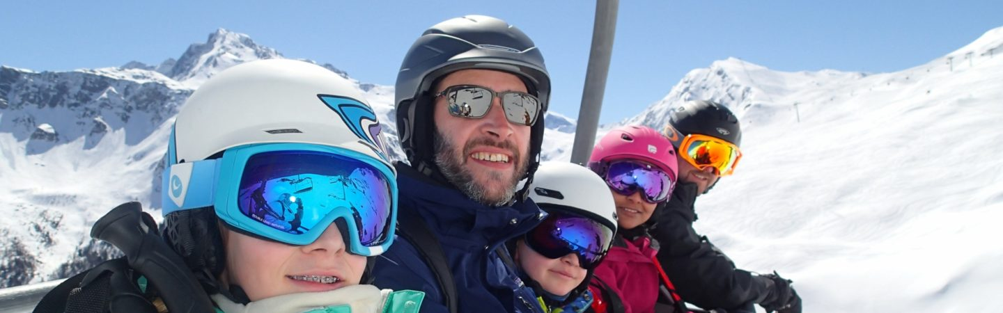 Family on chairlift in La Plagne