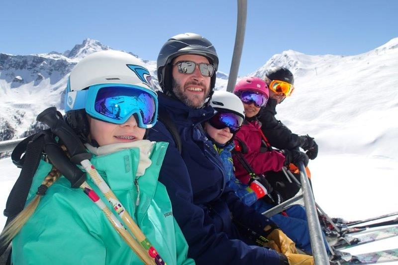 Family on chairlift in La Plagne